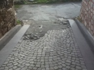 Eroding road near the entrance to the Church of Christs of Pantokrator