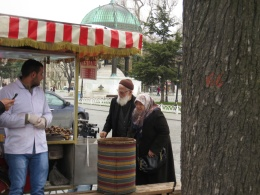 A couple buying hot chestnuts