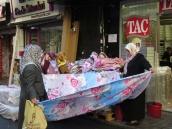 Two women folding the wares.