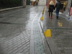 Low curbs and obvious bollards on walking streets allowing only deliveries.