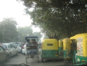 AutoRickshaws and a PediRickshaw