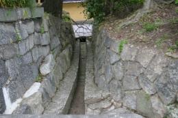 Drainage with trash rack between walkways between shrines, Kyoto