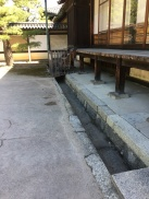 Deep Gutter next to the uninsulated shed of Tokugawa castle. The most opulent residence of the Shogun c. 1650 provided shelter from sun and wet, but not the cold.